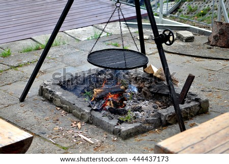 Steel fireplace grill outside - stock photo