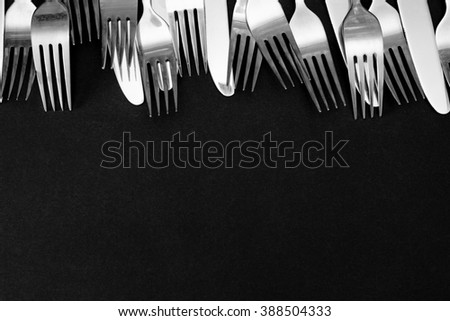 steel fork  on a black background - stock photo
