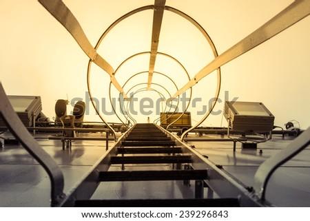 Steel ladder in battle ship - stock photo