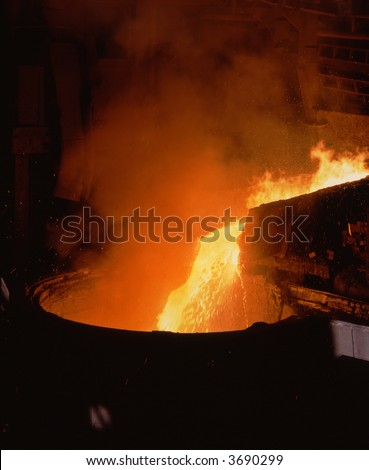 Steel making. liquid iron from the smelting stove. Steel is made in open-hearth furnaces using liguid iron-and-scrap process. Open-hearth furnace size is 300 and 600 tons. - stock photo