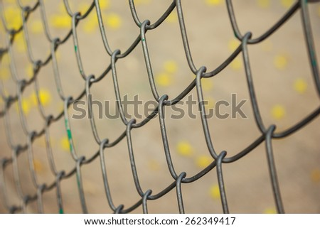 steel mesh fence outdoor soft focus - stock photo