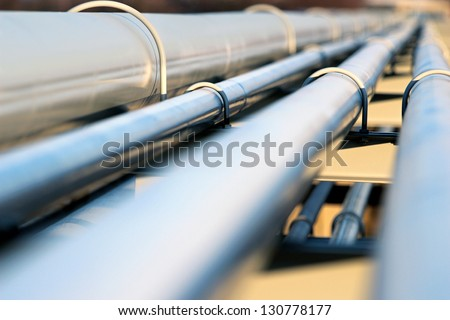 steel pipe in oil refinery - stock photo