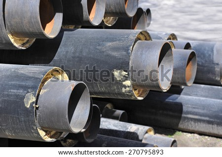 Steel pipe with heat insulation on construction site - stock photo