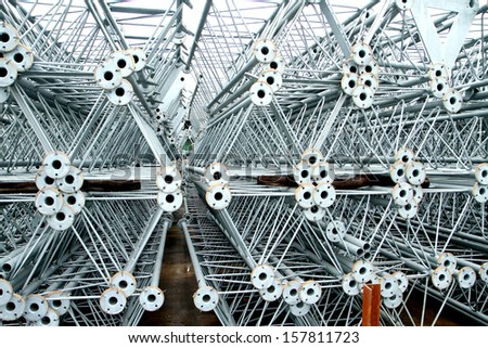 Steel pipes & bars for Telecommunication Tower - stock photo