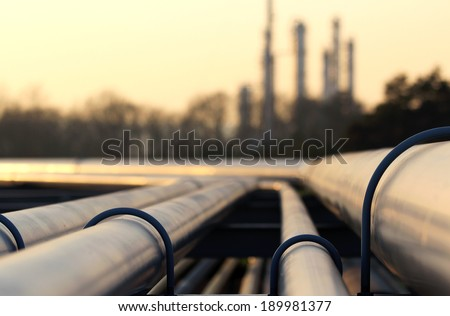 steel pipes in crude oil factory - stock photo