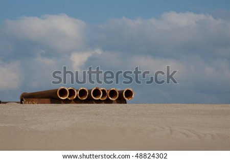 Steel-pipes on a dredging project - stock photo