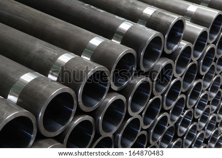steel pipes on black and white - stock photo