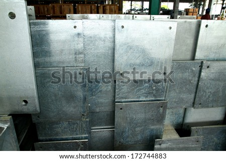 Steel plate bunch in warehouse before shipment - stock photo