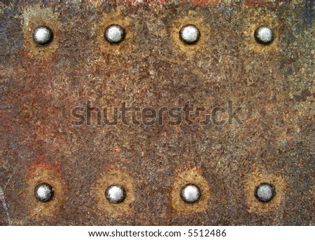 Steel plate with bright rivets - stock photo