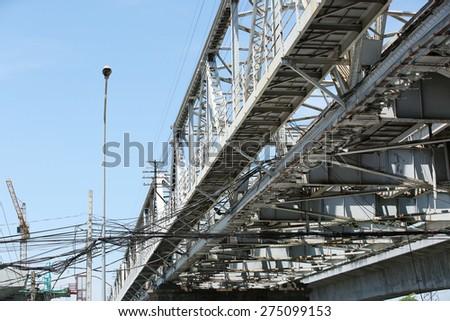 Steel railway bridge structure across Chaophraya river. - stock photo