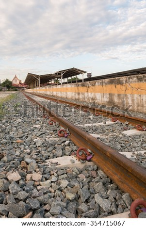 Steel railway tracks at the station - stock photo