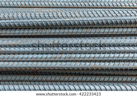 Steel reinforcement bar used to reinforce concrete at construction site. - stock photo