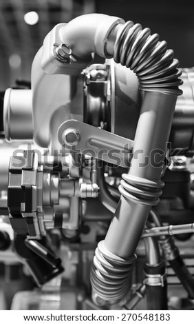Steel ribbed curved pipe of powerful modern engine, concept of new super sport car in monochrome  - stock photo