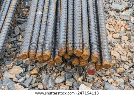 Steel rods or bars used to reinforce concrete in construction - stock photo