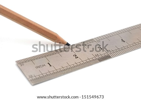 steel ruler and wood pencil on white - stock photo