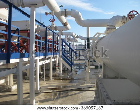 Steel service platform and stairs. Equipment refinery. - stock photo