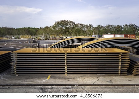 steel sheets deposited in stacks - stock photo