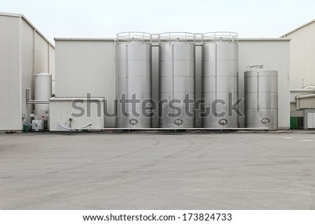 Steel silo for storing bulk materials for factory - stock photo