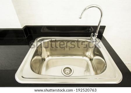 steel sink in a modern kitchen - stock photo