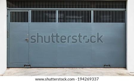 Steel sliding gate and door - stock photo