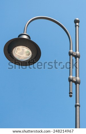 Steel Streetlight Pillar against the blue sky - stock photo