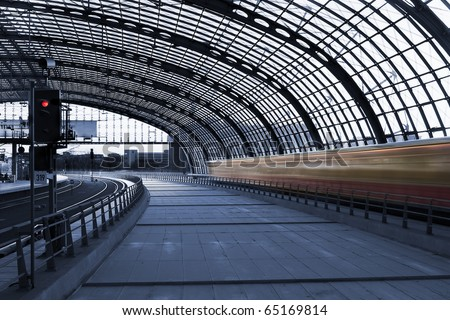 Steel structure main hall of Berlin central station (Hauptbahnhof), with a fast moving train at high speed, in a cyanotype composition - stock photo
