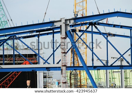 Steel structure of gas turbine power plant under-construction. - stock photo