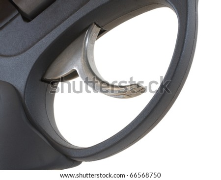 steel trigger and triggerguard that are found on a gun - stock photo