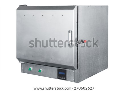 steel vacuum furnace on a white background - stock photo