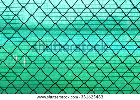 Steel Wire mesh on green slan background - stock photo