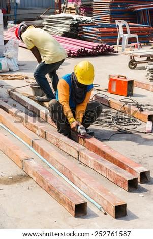 Steel Workers welding, grinding, cutting in metal industry - stock photo