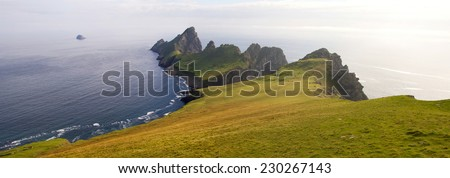 Steep cliffs on the remote island of Hirta (St Kilda). The Saint Kilda archipelago contains the largest colony of Gannets in Europe with more than 60,000 nests. - stock photo