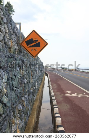 Steep grade 8 Percent hill traffic sign on road in thailand - stock photo