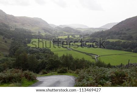 Steep hairpin bends on Handknott pass in English Lake District - stock photo