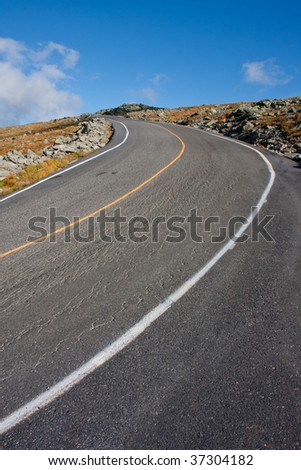 Steep road leading up to the top of Mount Washington - stock photo