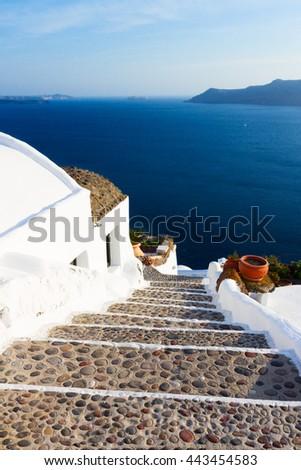steep stone stairs to the sea and volcano caldera, beautiful details of Santorini island, Greece - stock photo