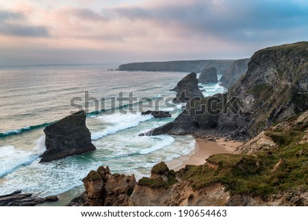 Steep treacherous cliffs at Bedruthan Steps on the north Cornwall coast - stock photo