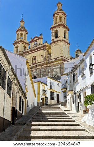 Steep village street leading to the Church (Parish of Our Lady of the Incarnation), Olvera, Cadiz Province, Andalusia, Spain, Western Europe - stock photo