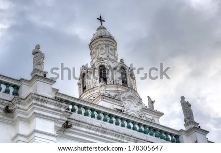 Steeple of Quito's Cathedral, with two statues on the side. Ecuador. - stock photo