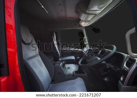 Steering truck inside cabin of heavy truck - stock photo