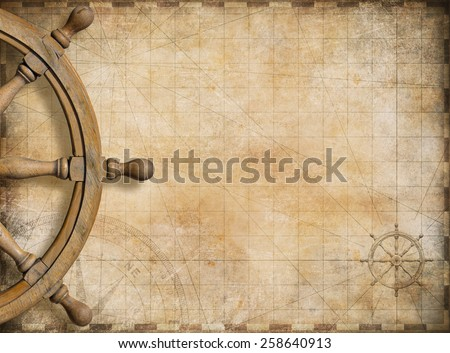 steering wheel and blank vintage nautical map background - stock photo