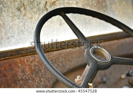 Steering Wheel and Dashboard from an old rusty car or truck - stock photo