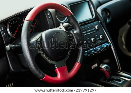 Steering wheel and dashboard in interior of the sports car - stock photo