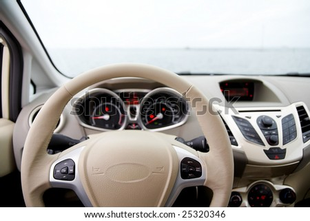 Steering wheel and dashboard of a car - stock photo