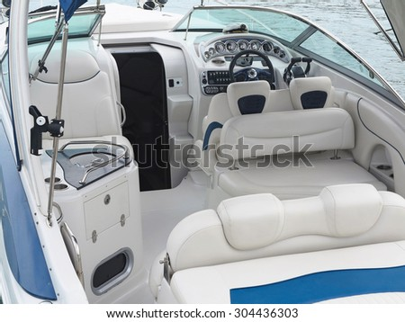 Steering wheel command pilot place on a white luxury yacht - stock photo