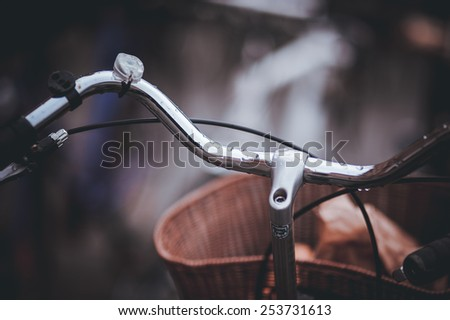 steering wheel of old  bicycle with  cart on front - stock photo