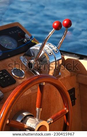 Steering wheel on luxury boat - stock photo