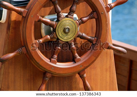 Steering Wheel Sailboat / Steering wheel of the old sail ship - stock photo