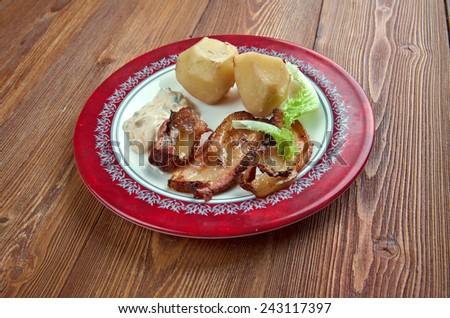 Stekt flask - Swedish dish of fried bacon, potatoes and gravy - stock photo