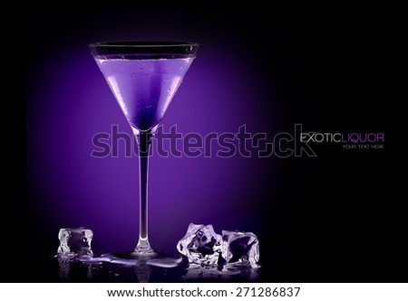 Stemmed cocktail glass with blackberry liquor and ice cubes on the table, close-up on purple and black background. Template design with sample text - stock photo